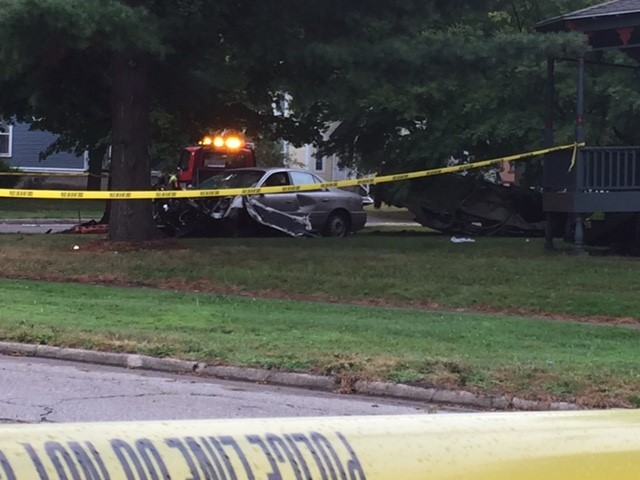 Both cars involved in an early morning crash ended up on the lawn of a home at Woodward and Kalamazoo avenues. (JESSICA WHEELER/WWMT)