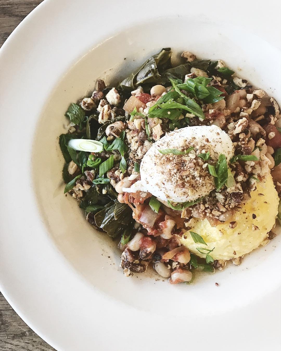 Bounty Kitchen's Potlikker Bowl;{&amp;nbsp;}Collard greens in potlikker sauce, pecans, polenta, black- eyed peas, Creole salsa, scallions, and a poached egg. (Image: Bounty Kitchen)<p></p>