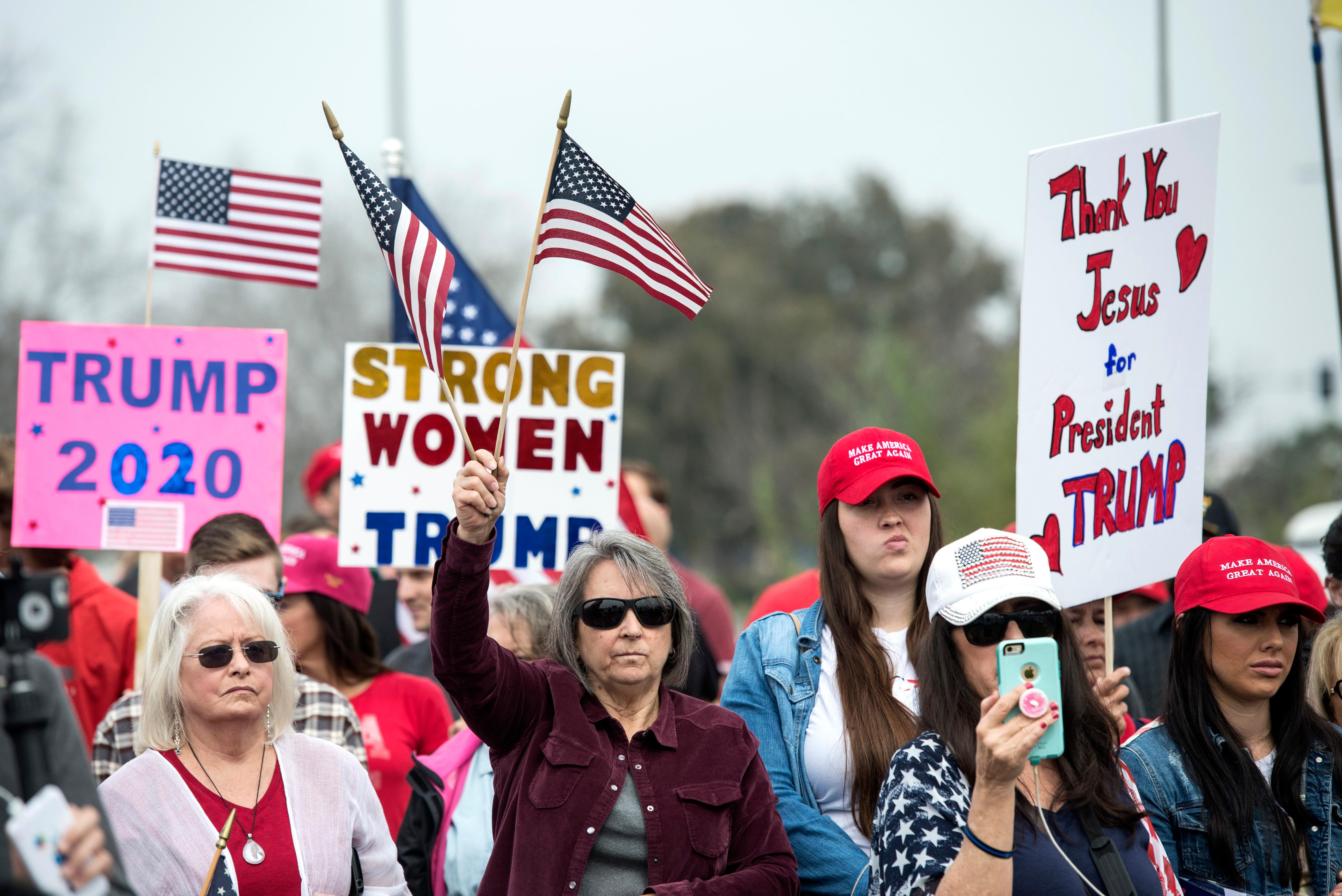 Supporters of President Trump gather for a rally Tuesday, March 13, 2018, in San Diego. (AP Photo/Kyusung Gong)