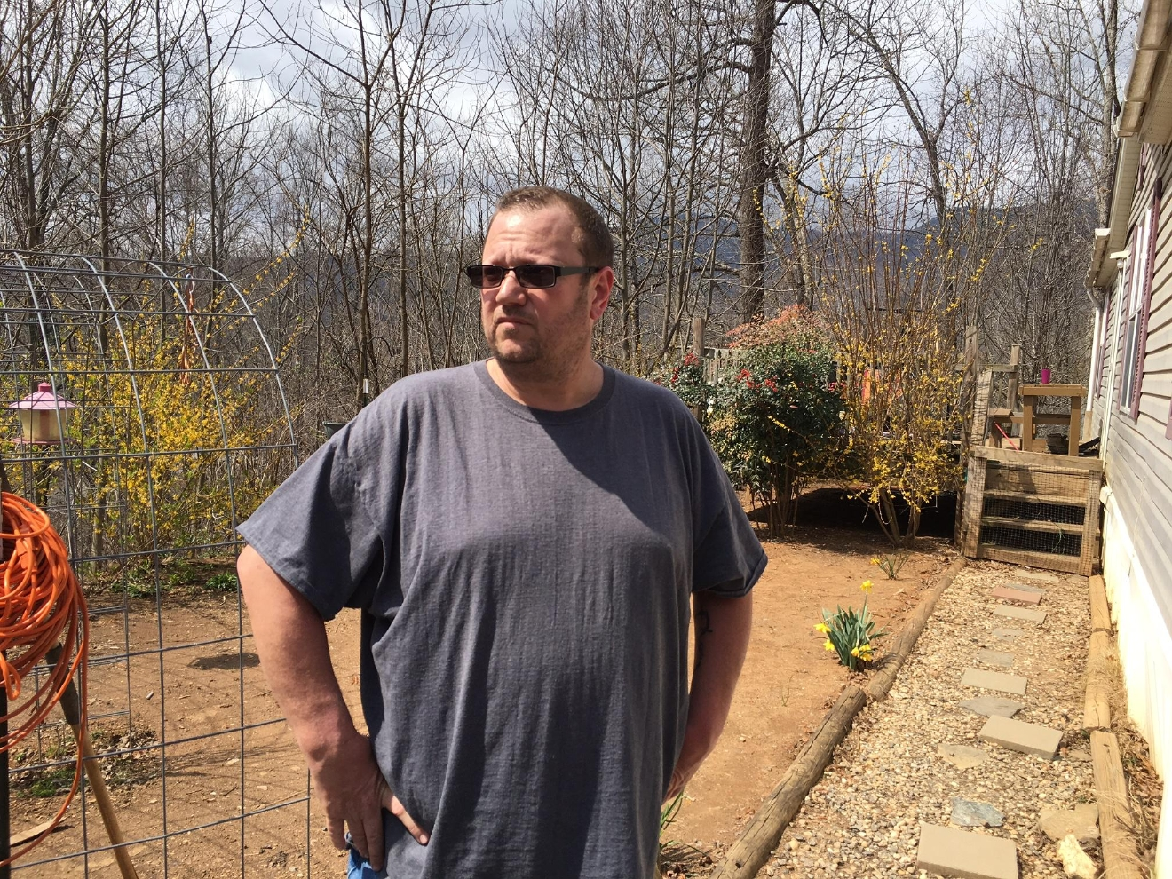 Jeff Guelcher, who is charged with felony animal abuse after shooting his neighbor's dog, said he had no choice after the dog threatened his chickens. (Photo credit: WLOS staff)