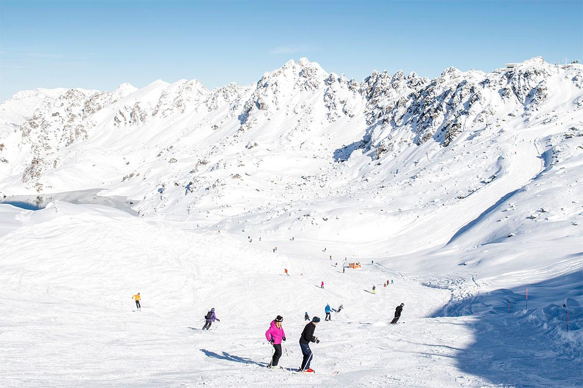 People ski down a slope during  sunny weather on the opening day of the ski season, in the ski resort of Verbier, Switzerland, Saturday, Nov. 12, 2016. (Leo Duperrex/Keystone via AP)