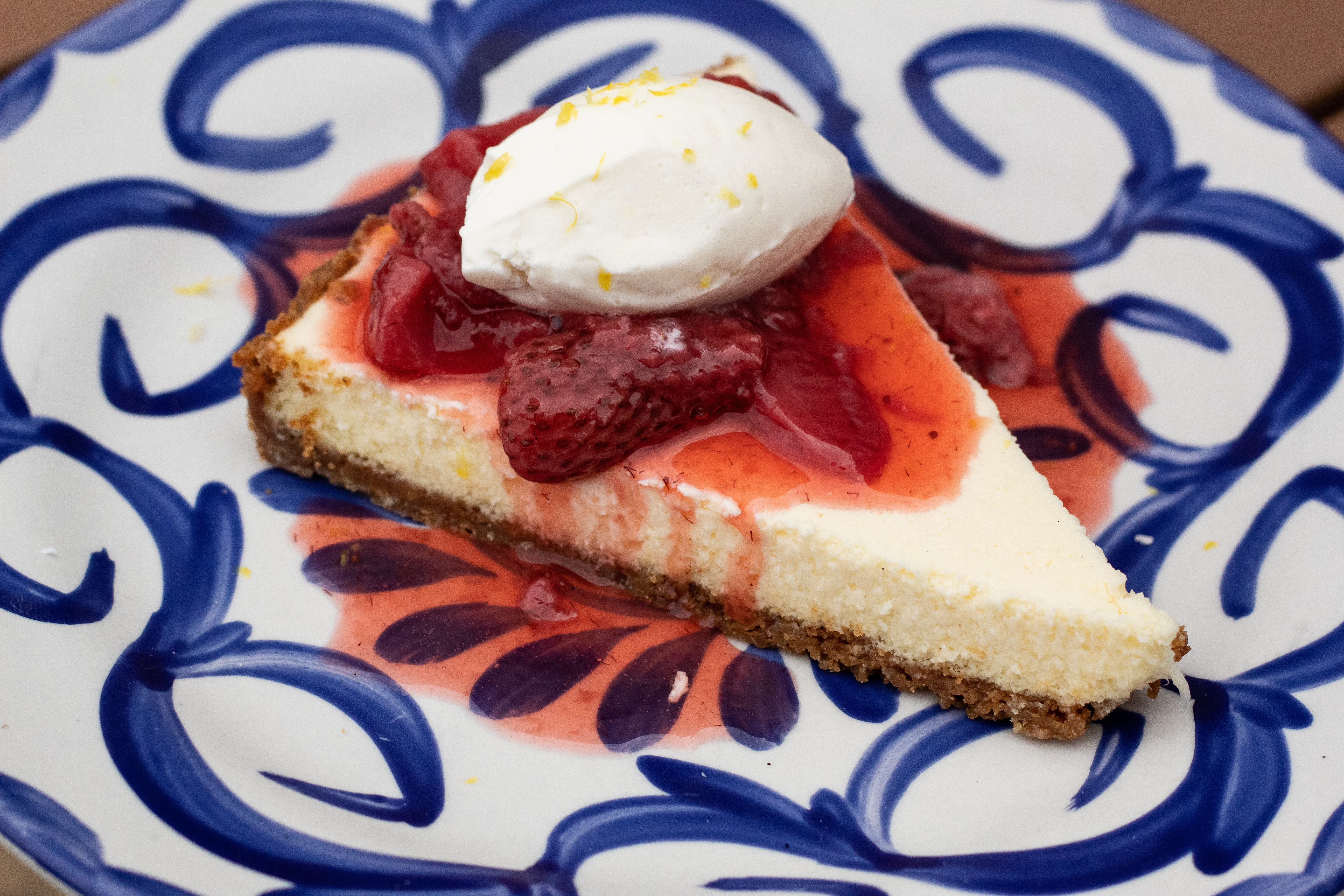 <p>At the All Purpose Capitol Riverfront, make your way to the patio or the roof deck and end your meal with the Brooklyn-style cheesecake with graham cracker crust, strawberry conserva, whipped cream and lemon zest. (Image: Courtesy All Purpose)</p>