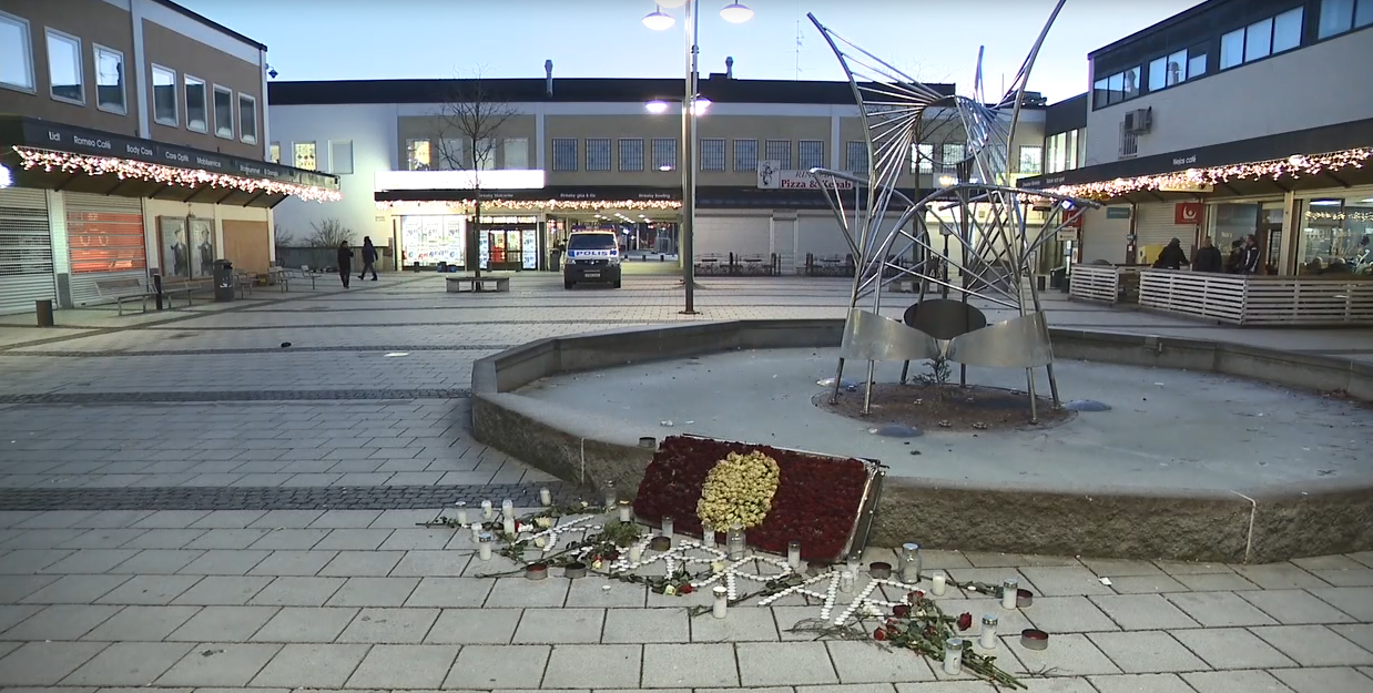 A memorial honors a man's life after he was shot to death in a suburb of Stockholm. The day before our team arrived, a young man was murdered in the pizza shop behind the memorial after he was shot in the head at dinner time. (Sinclair Broadcast Group)