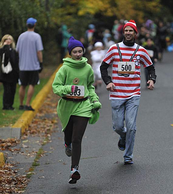 Runners participate in the Monster Dash One mile fun run/walk at Lithia Park in Ashland on Saturday. Daily Tidings / Jamie Lusch - Jamie Lusch