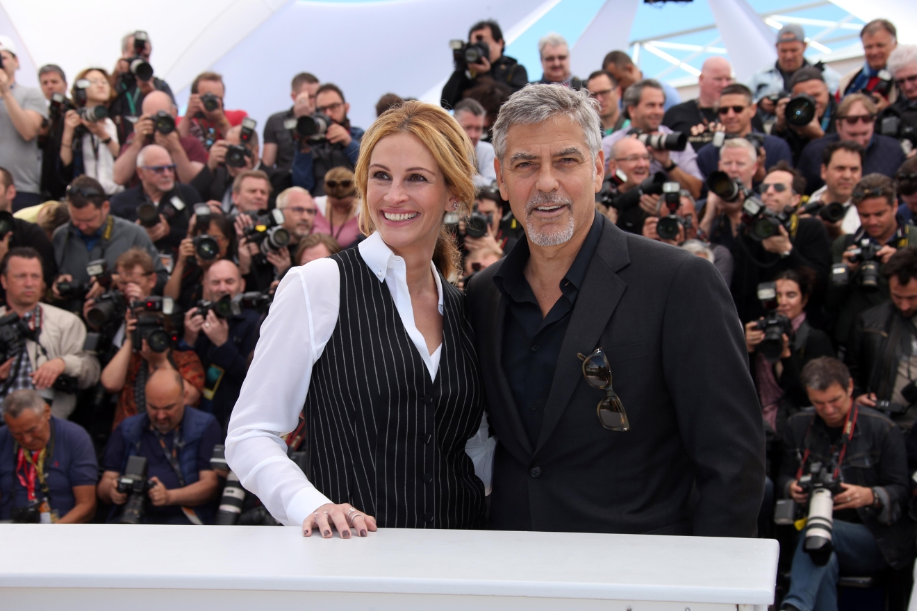 Actor George Clooney, right, and actress Julia Roberts pose for photographers, during a photo call for the film Money Monster at the 69th international film festival, Cannes, southern France, Thursday, May 12, 2016. (AP Photo/Joel Ryan)