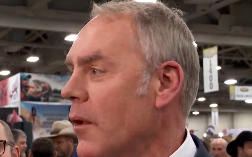 Zinke signs order at SLC Hunting Expo (Photo: KUTV)