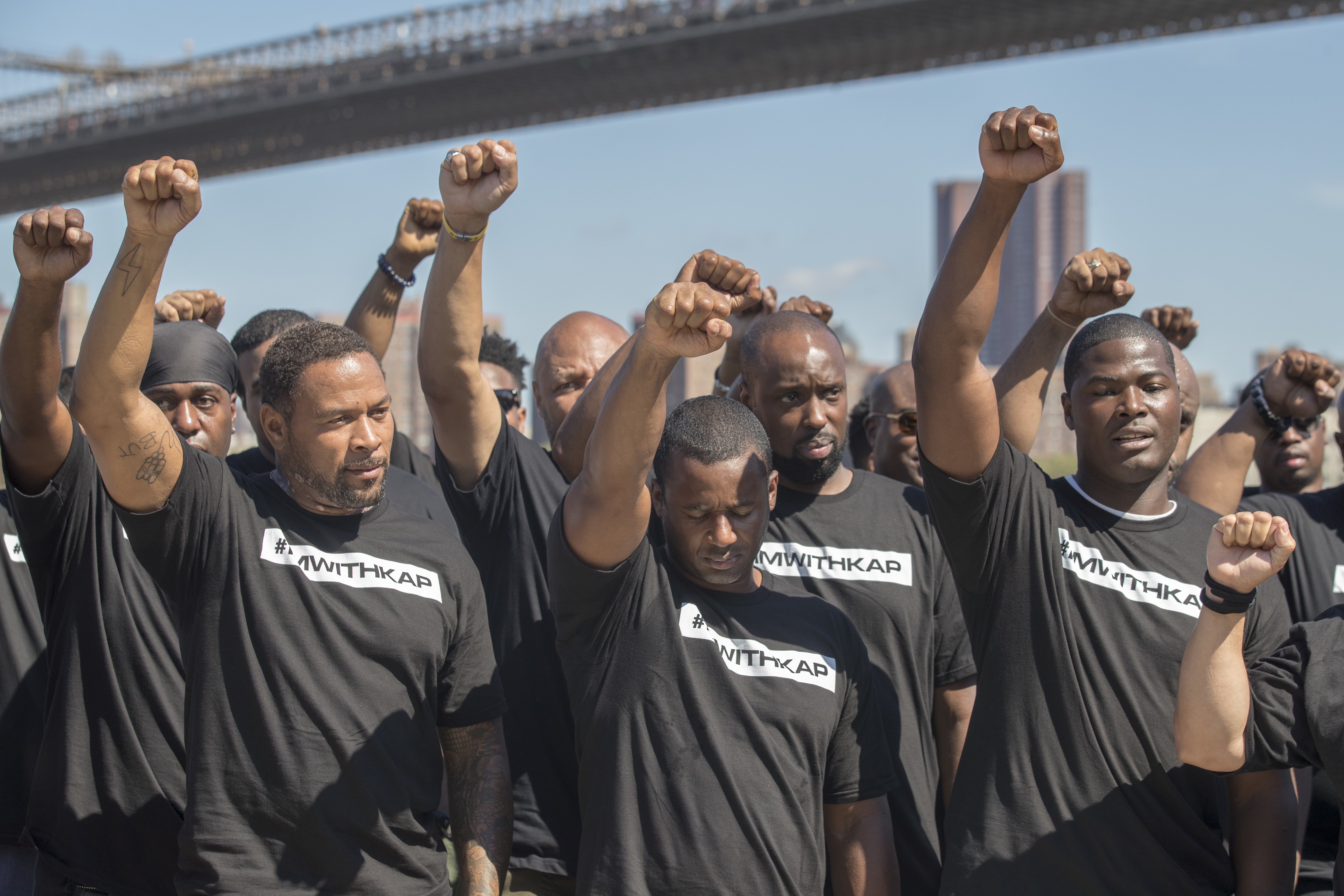 Members of law enforcement raise their fists during a rally to show support for Colin Kaepernick, Saturday, Aug. 19, 2017, in New York. (AP Photo/Mary Altaffer)<p></p>