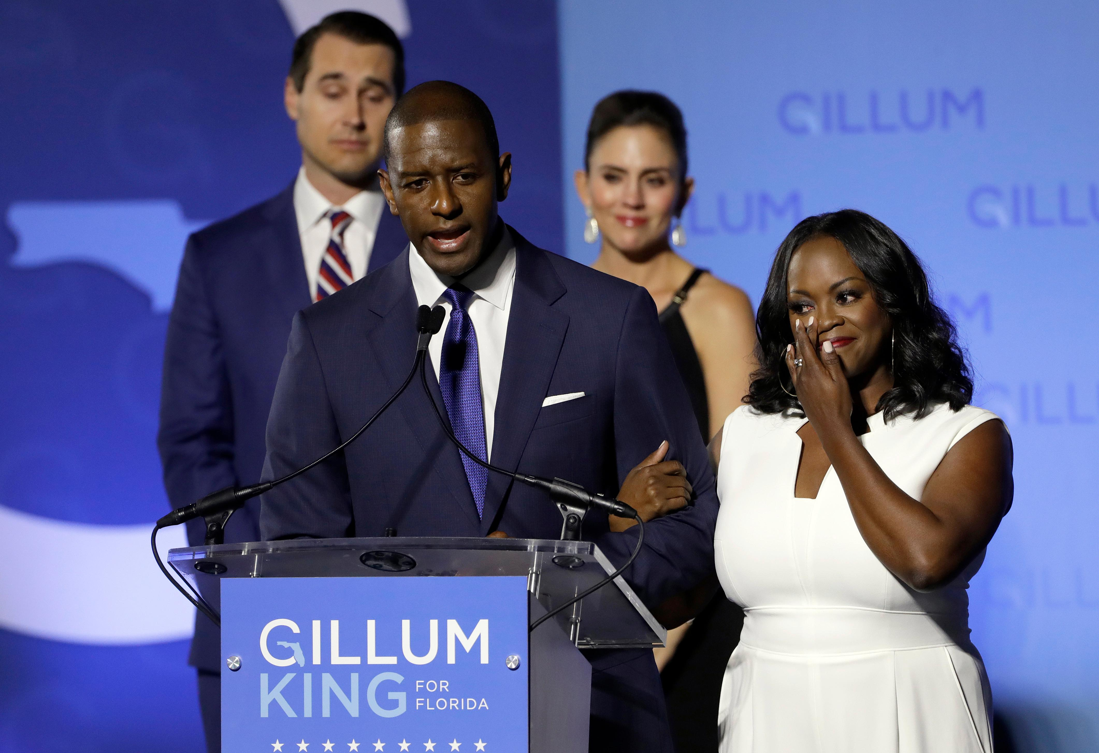 Florida Democratic gubernatorial candidate Andrew Gillum gives his concession speech as he is joined on stage by his wife R. Jai Gillum, right, and running mate Chris King and his wife Kristen. (AP Photo/Chris O'Meara)