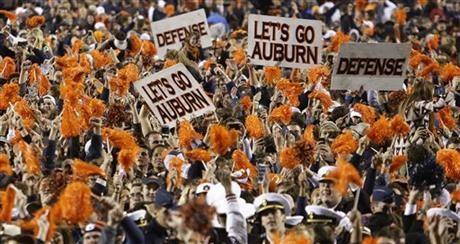 Auburn fans storm the field after their 34-28 a win over No. 1 Alabama in an NCAA college football game in Auburn, Ala., Saturday, Nov. 30, 2013. (AP Photo/Jay Sailors)