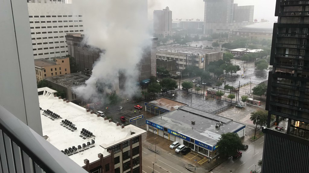 A building caught fire in Houston, Monday, Aug. 28, 2017, as flooding from Tropical Storm Harvey ravaged the city. (Chris Hisle [Twitter/@cspwal])