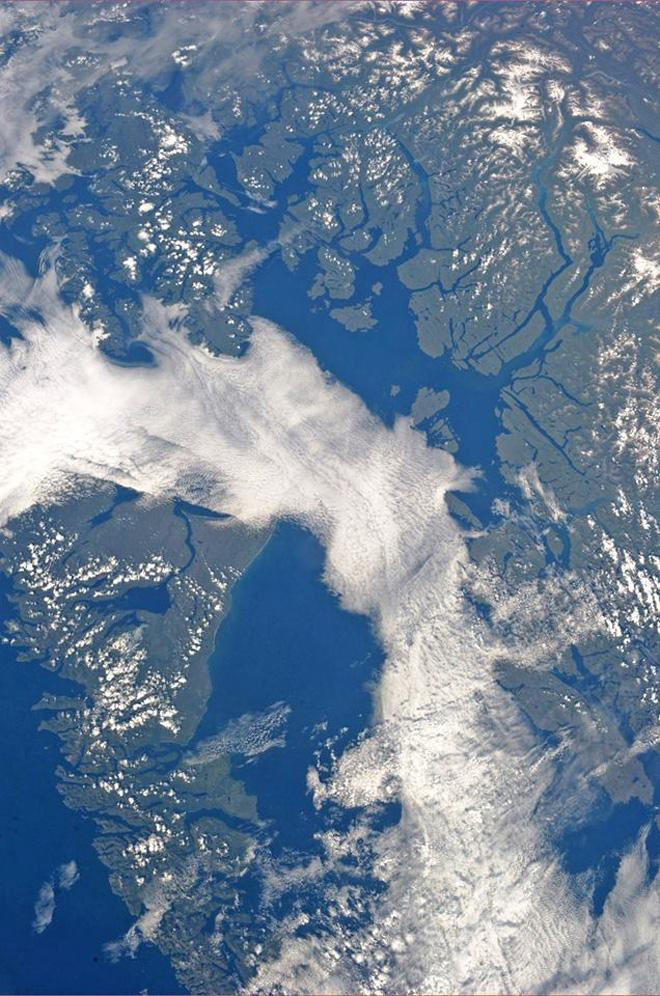 Cloud covered Dixon Entrance and Hecate Strait bordering Alaska and British Columbia (Photo & Caption: Karen Nyberg, NASA)