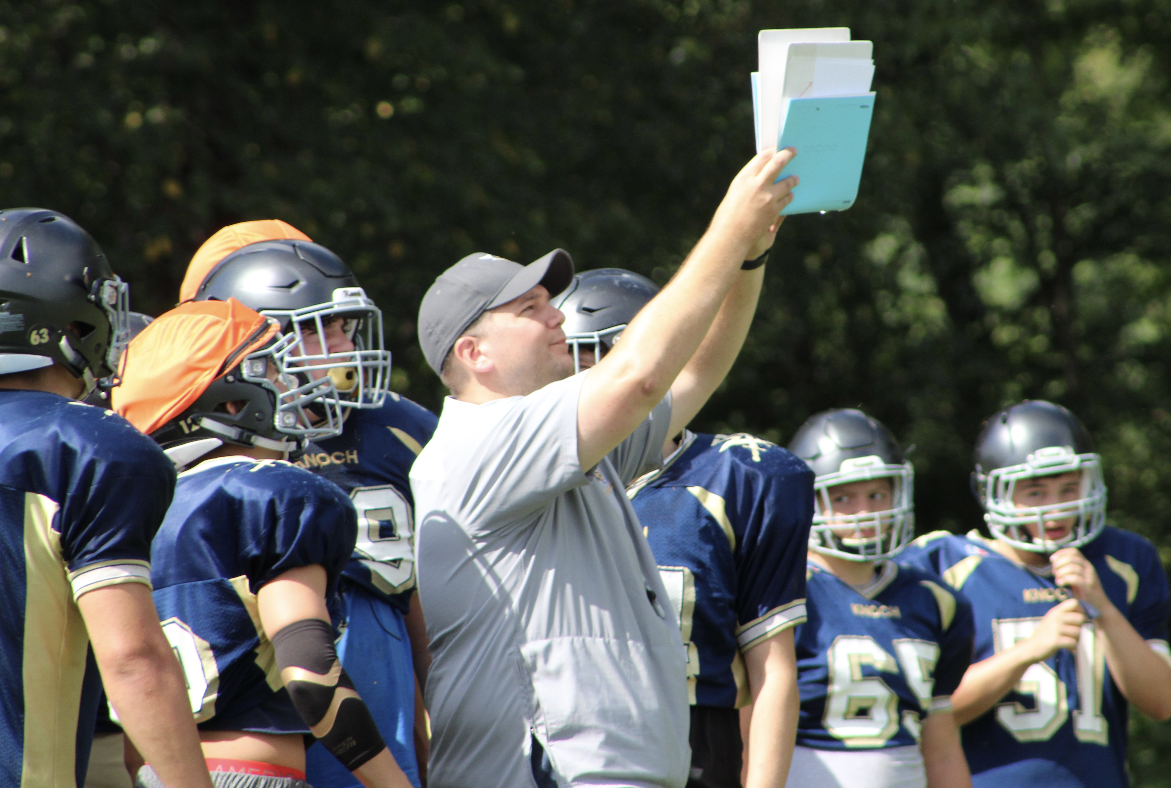 "New Knoch High School Head Coach Brandon Mowry calls a play during an August practice. Watch the AHN Friday Night Rivals powered by IGS Energy ""Kickoff Special"" Aug. 23 at 7 p.m. on 22 the Point.<p></p>"