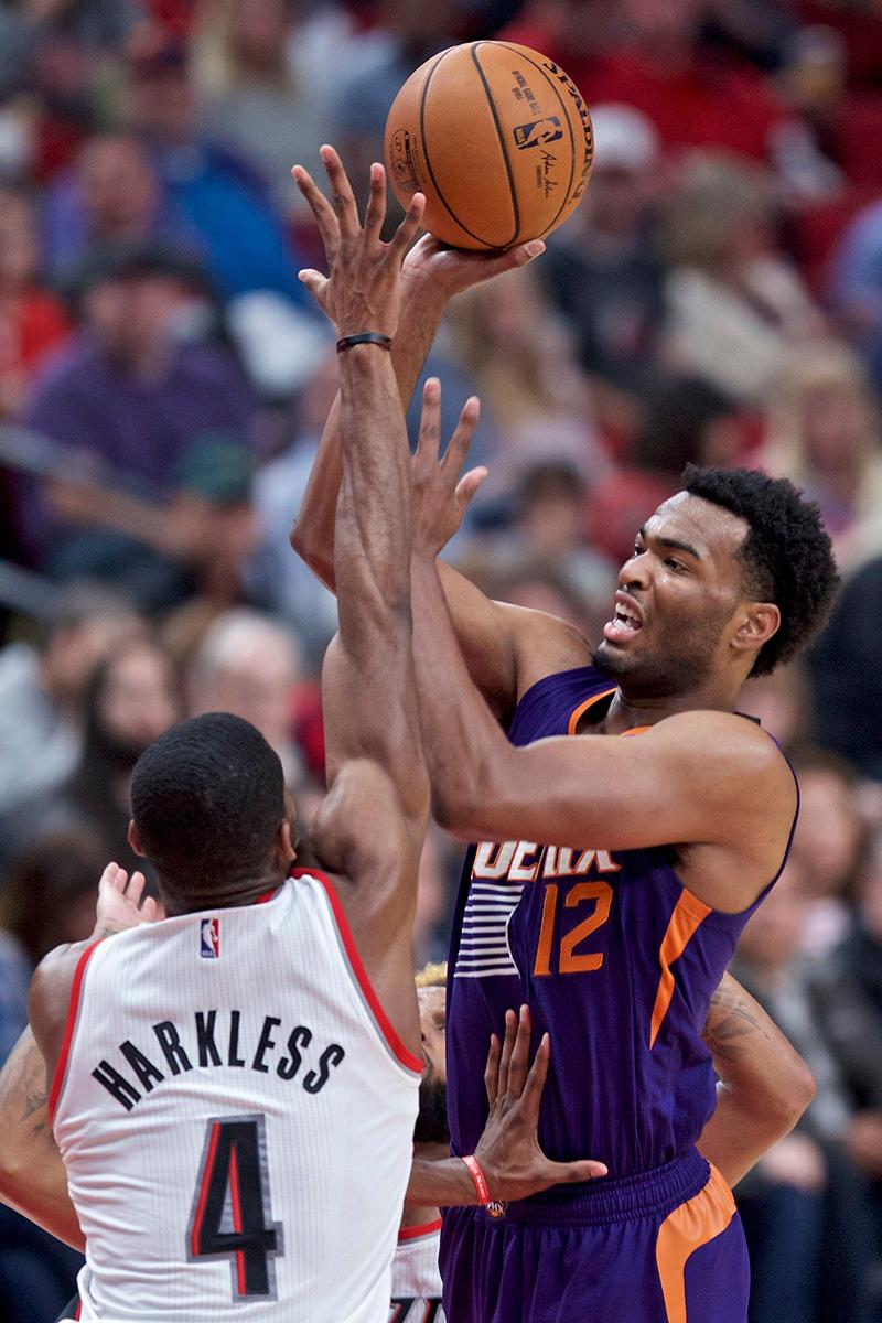Phoenix Suns forward TJ Warren shoots over Portland Trail Blazers forward Maurice Harkless during the second half of an NBA basketball game in Portland, Ore., Tuesday, Nov. 8, 2016. (AP Photo/Craig Mitchelldyer)