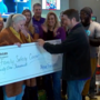 Local agency donates $31,000 to Tulsa organization for domestic abuse victims