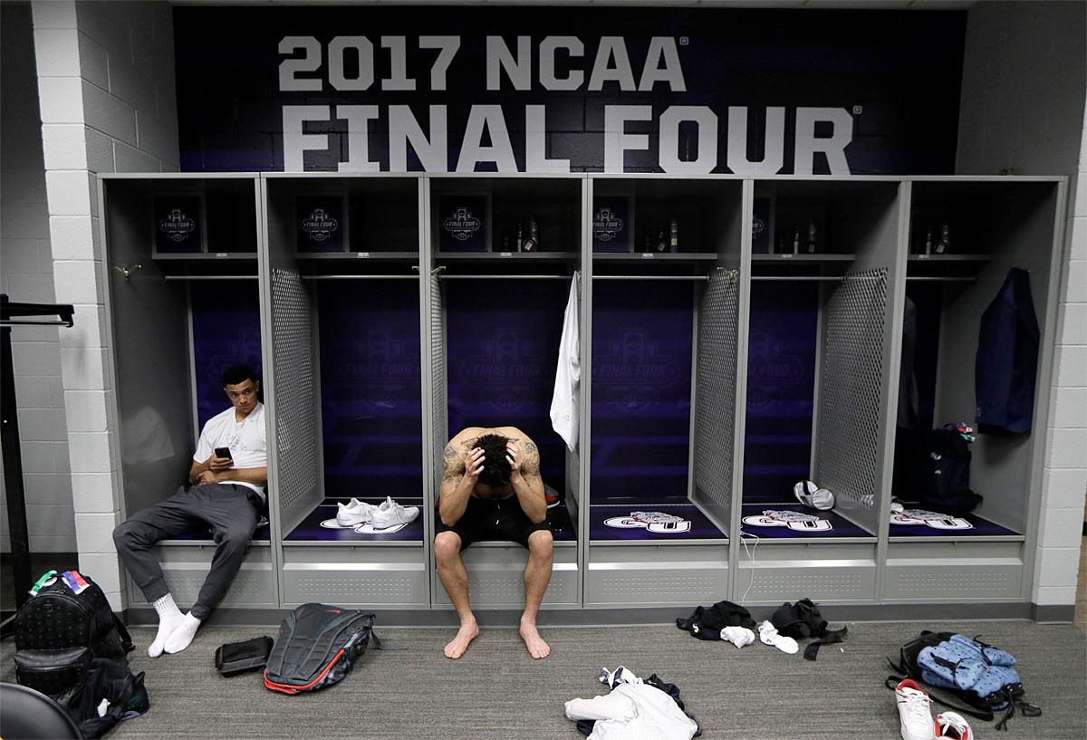 Gonzaga's Bryan Alberts, left, and Josh Perkins sit in the locker room after the finals of the Final Four NCAA college basketball tournament against North Carolina, Monday, April 3, 2017, in Glendale, Ariz. North Carolina won 71-65. (AP Photo/Mark Humphrey)