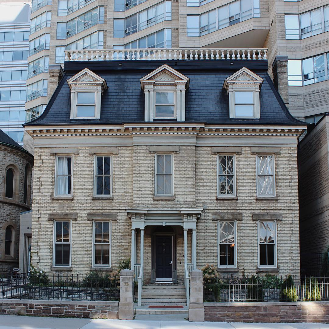 "IMAGE: IG user @arconserv / POST: ""Interesting to see a condo built around, not directly on top, a heritage building (St. Andrews Manse, Toronto, 1873, designed by Robert Grant)."" / MORE: Check out #MansardMonday by following IG user @archi_ologie"