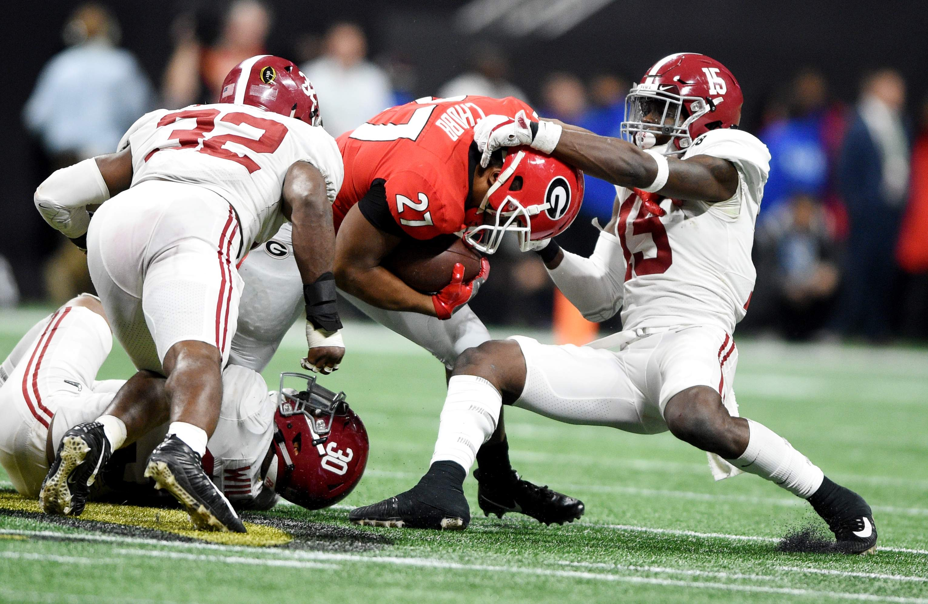 Alabama defenders wrestle down Georgia's Nick Chubb during the 2018 College Football Playoff National Championship at Mercedes-Benz Stadium in Atlanta, Ga., Monday afternoon January 8, 2018. MICHAEL HOLAHAN/AUGUSTA CHRONICLE