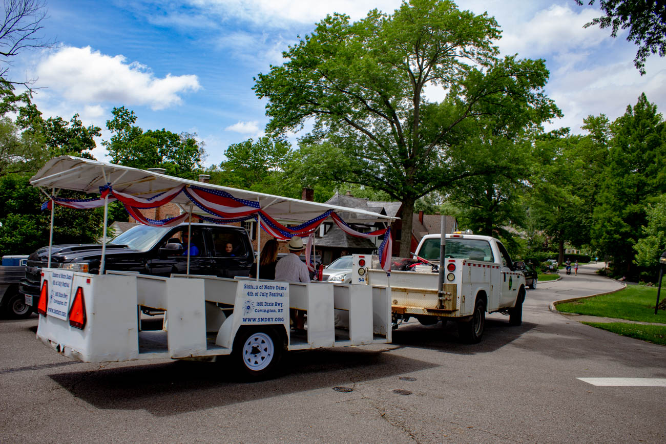 A trolley donated from the Sisters of Notre Dame, a school bus, and multiple golf carts strolled throughout the neighborhood to shuttle people to the different gardens. / Image: Katie Robinson, Cincinnati Refined // Published: 6.24.19