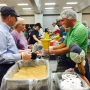 Volunteers packing 300,000 meals for people in need