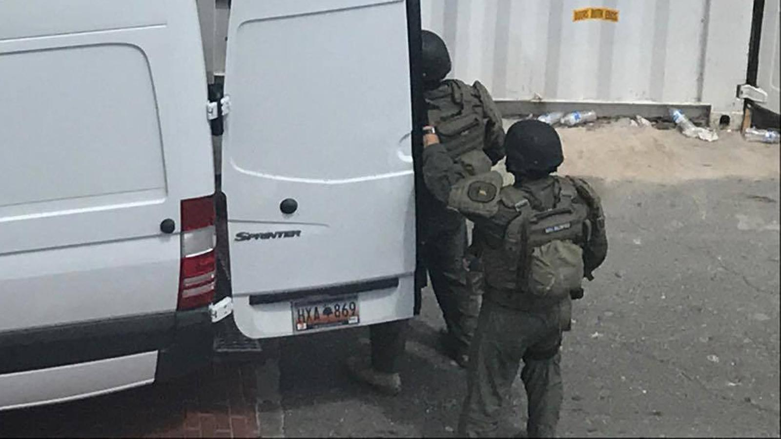 Armored SWAT team members exit a van near the scene of Thursday's shooting. (Provided/Robbie Kimbrough)