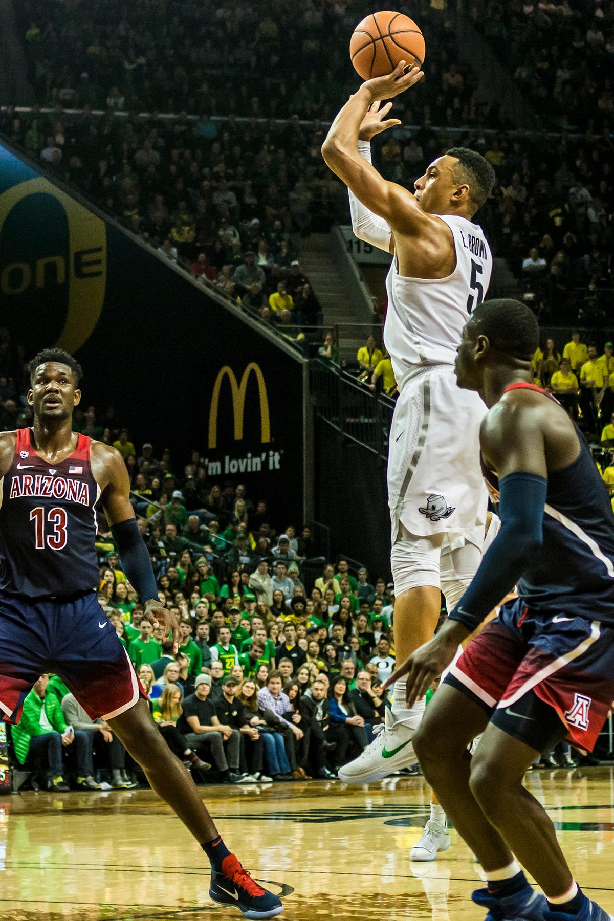Oregon's Elijah Brown (5) shoots against the Arizona Wildcats in their matchup at Matthew Knight Arena Saturday. The Ducks upset the fourteenth ranked Wildcats 98-93 in a stunning overtime win in front of a packed house of over 12,000 fans for their final home game to improve to a 19-10 (9-7 PAC-12) record on the season. Oregon will finish out regular season play on the road in Washington next week against Washington State on Thursday, then Washington on the following Saturday. (Photo by Colin Houck)