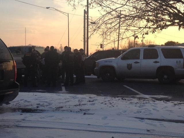 OBN agents gather as dawn breaks in Garvin County to arrest more suspects accused of distributing methamphetamine.