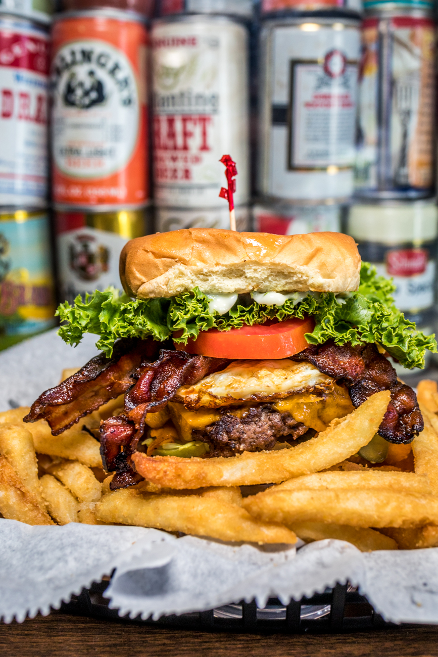 The Hangover Henry: 1/2 pound beef burger, cheddar cheese, fried egg, 2 strips of bacon, lettuce, tomato, chopped onion, pickle, and mayonnaise on a heavy duty bun / Image: Catherine Viox{ }// Published: 9.4.20