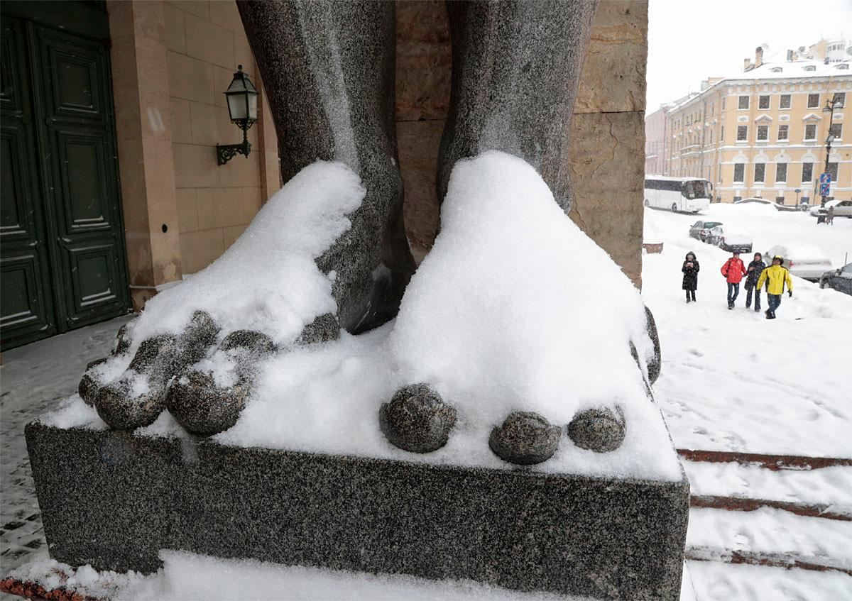 Snow covers the sculpture of Atlas at the State Hermitage museum in St. Petersburg, Russia, Tuesday, Nov. 8, 2016. Low temperatures caused two days of snowfall in St. Petersburg. (AP Photo/Dmitri Lovetsky)