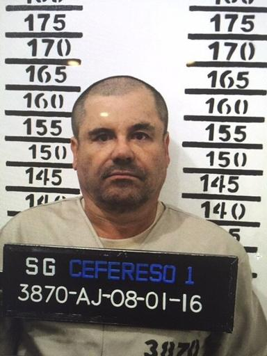 "FILE - In this Jan. 8, 2016 file photo released by Mexico's federal government, Mexico's drug lord Joaquin ""El Chapo"" Guzman stands for his prison mug shot with the inmate number 3870 at the Altiplano maximum security federal prison in Almoloya, Mexico. According to Mexico's Foreign Ministry, Guzman was extradited to the United States on Thursday, Jan. 19 2017. (Mexico's federal government via AP, File)"