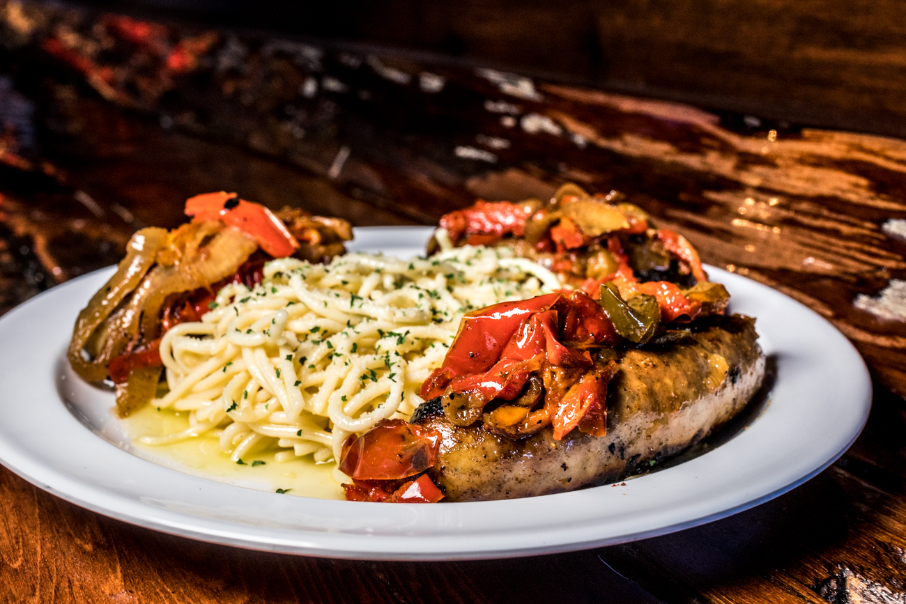 Italian Sausage and Peppers: grilled Italian sausage with grilled peppers and onions and served with spaghetti tossed in olive oil and herbs / Image: Catherine Viox{ }// Published: 2.3.20