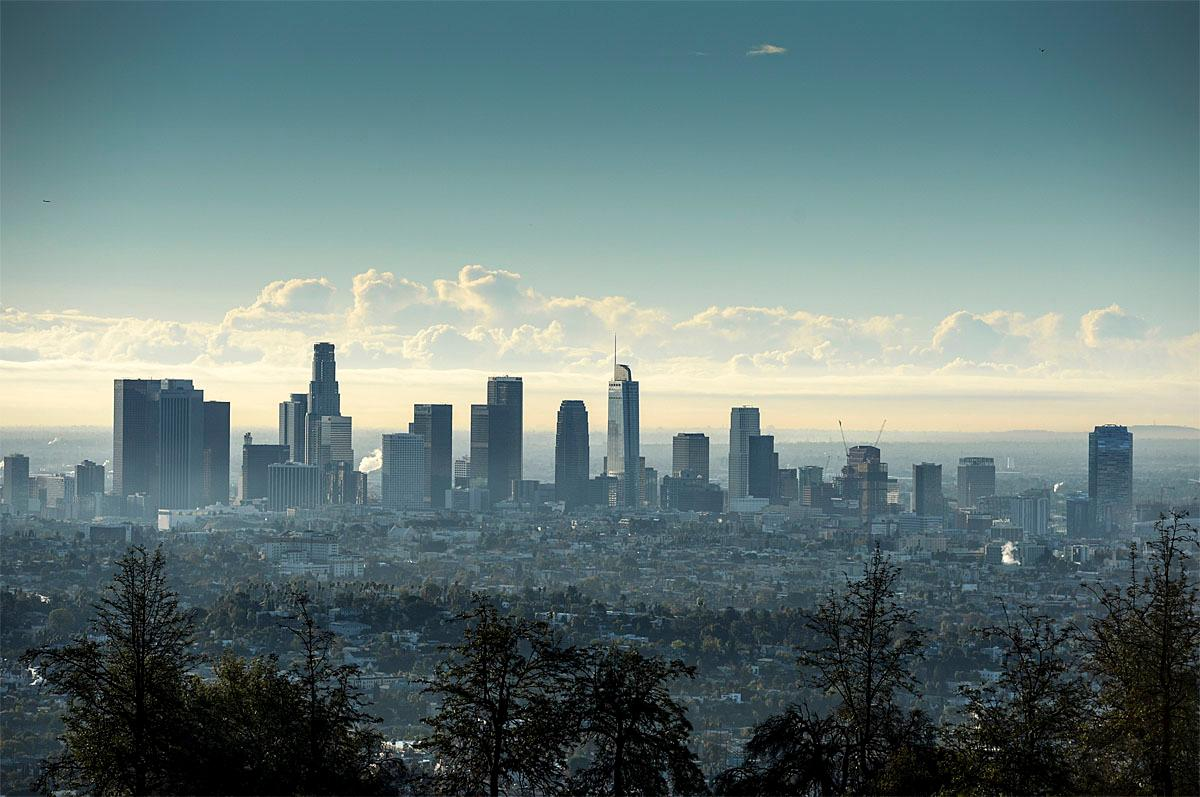 The last clouds clear out above Los Angeles Monday morning after an overnight storm dropped more than an inch of rain in some areas. Skies are clearing in much of Southern California after a wet autumn storm packing heavy rain flooded roads and knocked out power to thousands. (David Crane/Los Angeles Daily News/SCNG) (David Crane/Los Angeles Daily News via AP)