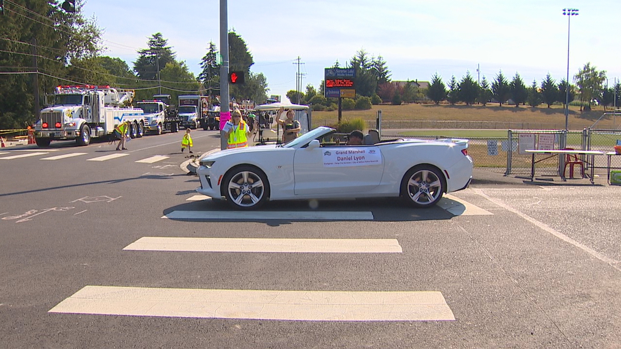 Photos injured firefighter serves as parade grand marshal komo daniel lyon who injured in the devastating twisp wildfire last year served as the sciox Images