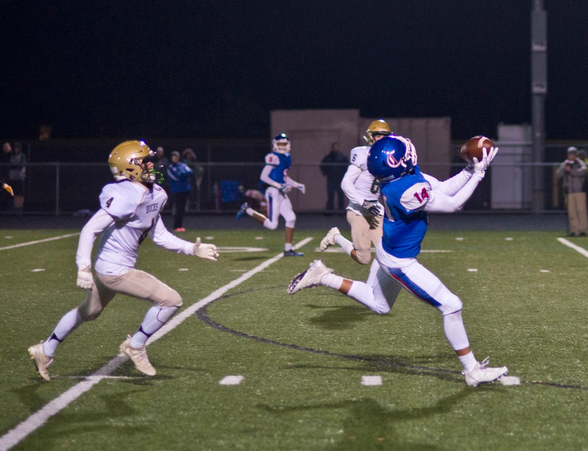 Churchill Lancers wide receiver Myles Green-Richards (#14) hauls in a long pass and scores against the Pendleton Buckeroos. The Churchill Lancers defeated the Pendleton Buckaroos 42-15, in the first round of the state 5A playoffs. Photo by Dan Morrison, Oregon News Lab