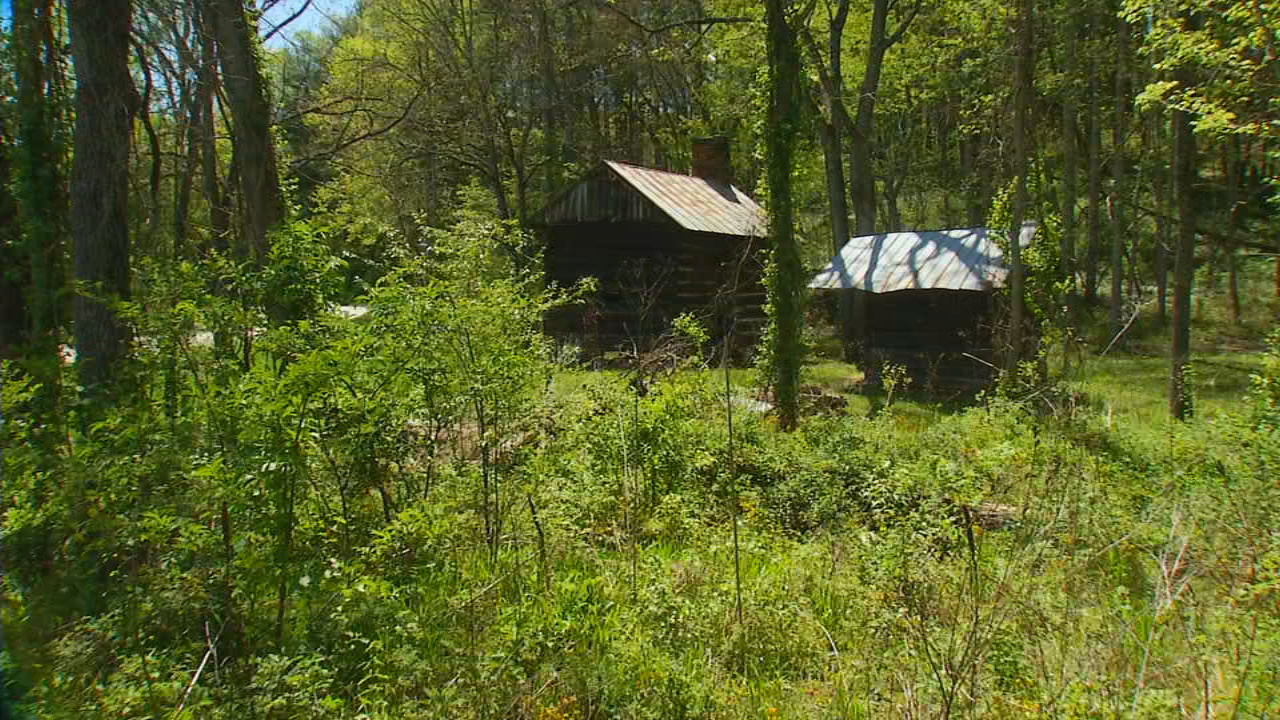 """There is a one-room, old log house at the corner of Emmas Grove Road and Number Nine Road in Fairview,"" Doug Brown wrote to Ask 13. ""What is the history behind this structure?"" (Photo credit: WLOS Staff)"