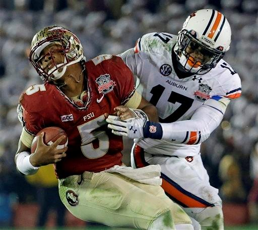 Auburn's Kris Frost tackles Florida State's Jameis Winston on a run during the second half of the NCAA BCS National Championship college football game Monday, Jan. 6, 2014, in Pasadena, Calif.