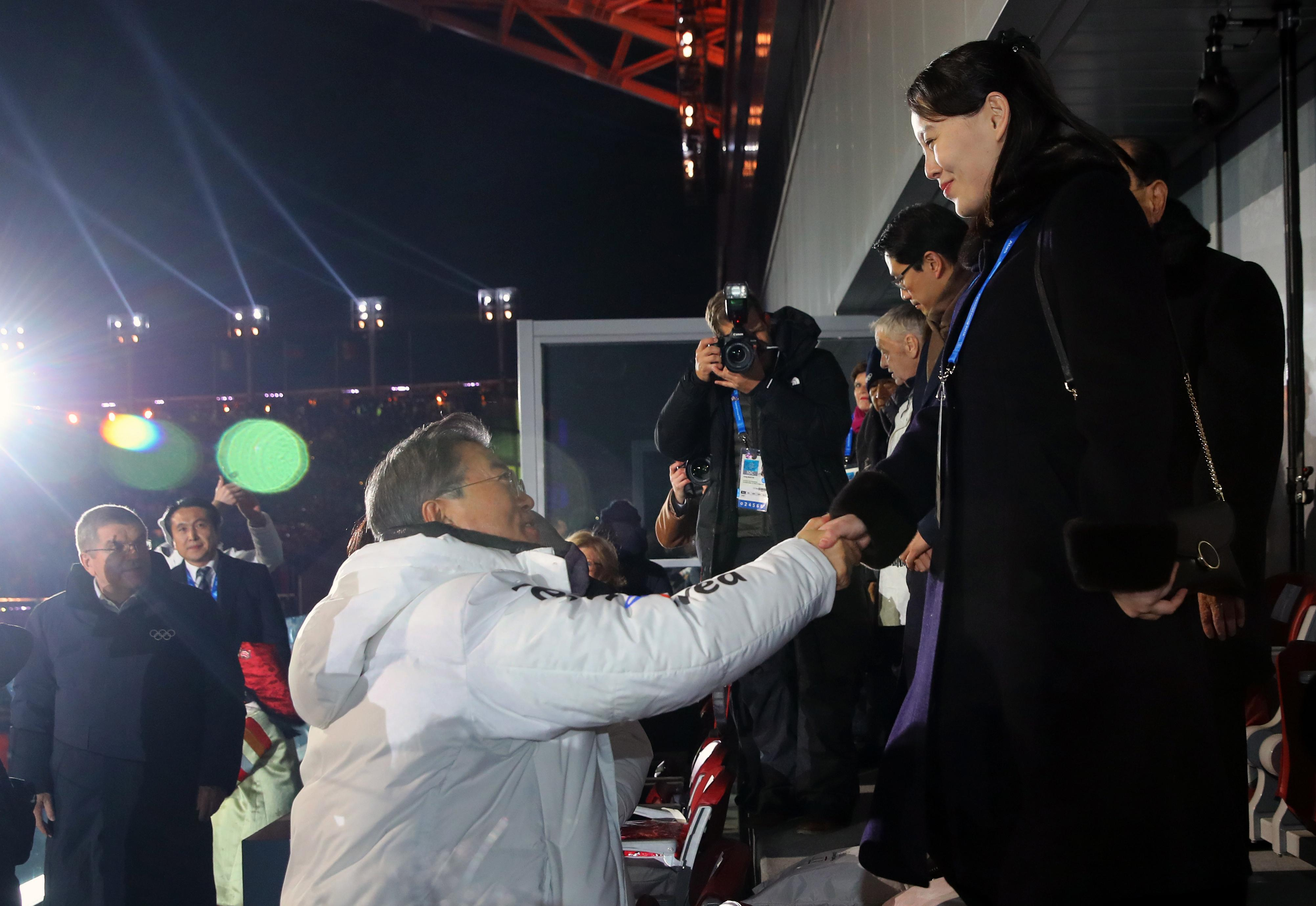 South Korean President Moon Jae-in, left, shakes hands with North Korean leader Kim Jong Un's younger sister Kim Yo Jong during the opening ceremony of the 2018 Winter Olympics in Pyeongchang, South Korea, Friday, Feb. 9, 2018. (Kim Ju-sung/Yonhap via AP)