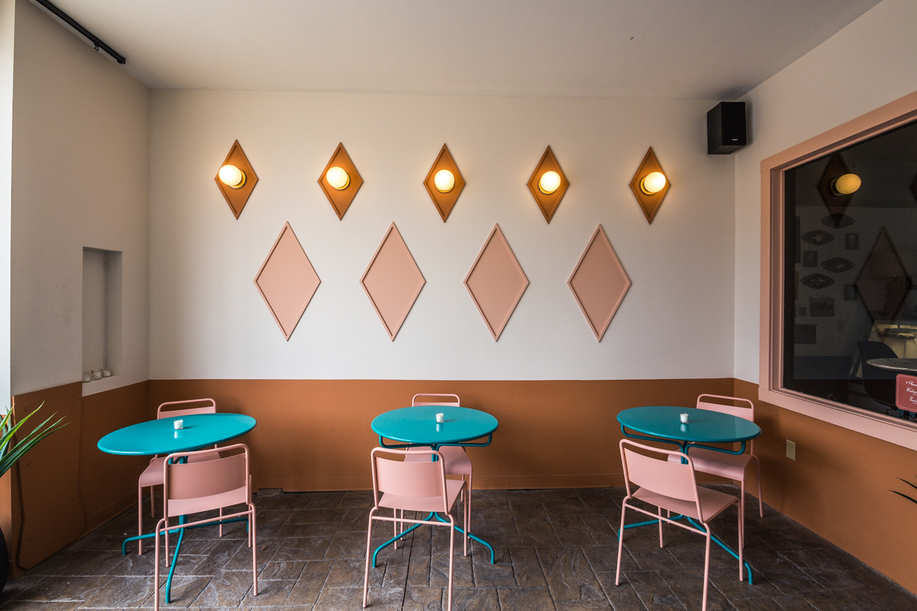 The Pleasant Ridge spot features a Midcentury modern motif, inspired by casual roadside stops scattered across the U.S. Trevino says the restaurant's concept comes from his infatuation with similar steak spots he dined at while growing up in Texas. He decided to recreate the nostalgic feeling from his childhood by bringing a retro steakhouse to Cincinnati. / Image: Catherine Viox // Published: 4.11.19