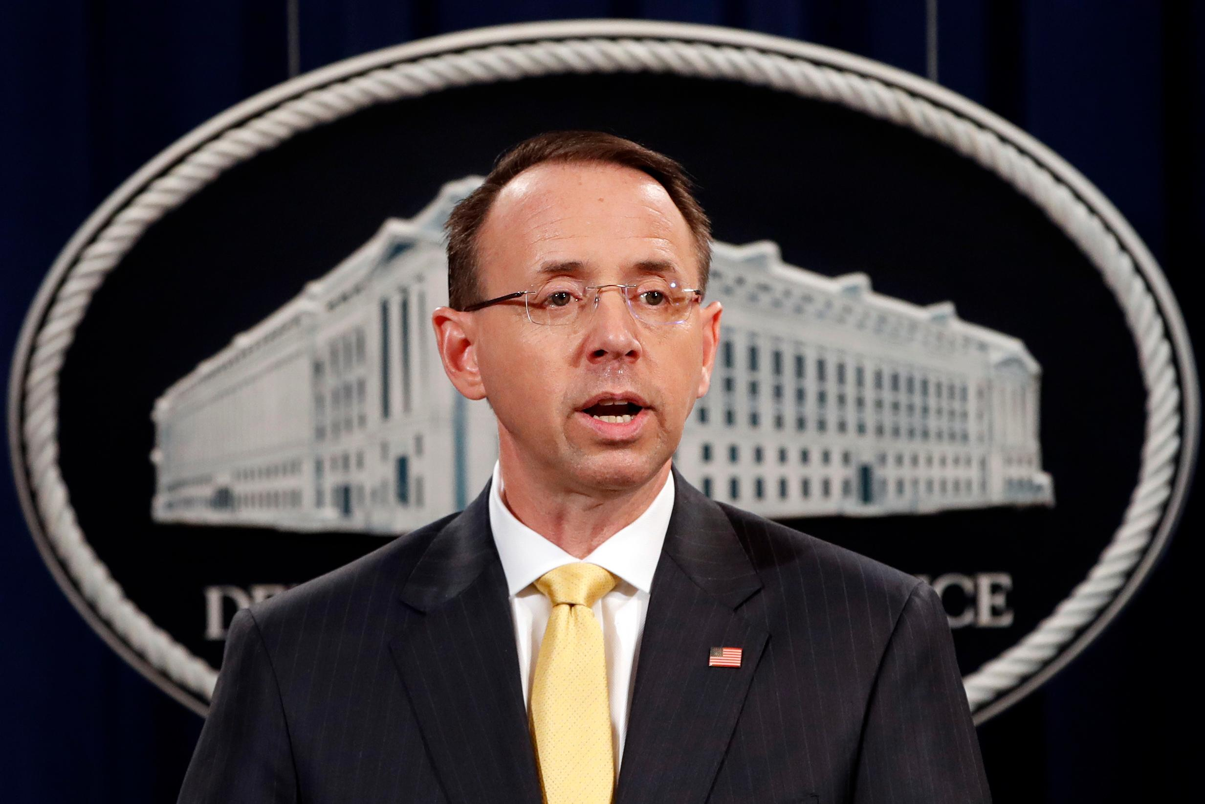 FILE - Deputy Attorney General Rod Rosenstein, speaks to the media with an announcement that the office of special counsel Robert Mueller says a grand jury has charged 13 Russian nationals and several Russian entities, Friday, Feb. 16, 2018, in Washington. The defendants are accused of violating U.S. criminal laws to interfere with American elections and the political process. (AP Photo/Jacquelyn Martin)