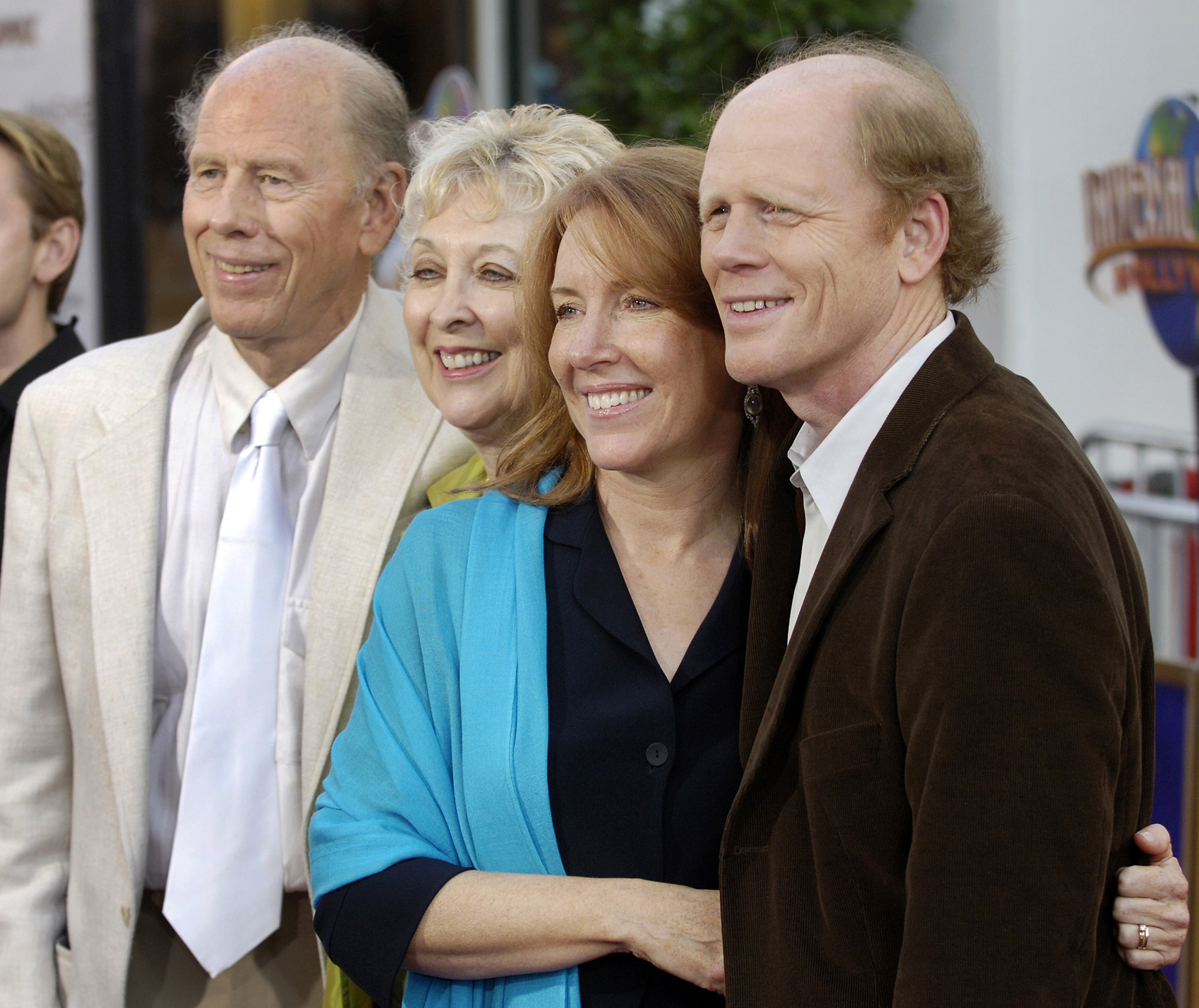 "FILE - In this May 23, 2005, file photo, Ron Howard, far right, director of the new film ""Cinderella Man,"" poses with his wife Cheryl, second from right, and his parents, actor/director Rance Howard and actress Jean Speegle Howard, at the premiere of the film in the Universal City section of Los Angeles. Director Ron Howard says his actor father Rance Howard has died at age 89. Howard announced his father's passing Saturday, Nov. 25, 2017, on Twitter. He praised his father for his ability to balance ambition with great personal integrity.  (AP Photo/Chris Pizzello, File)"