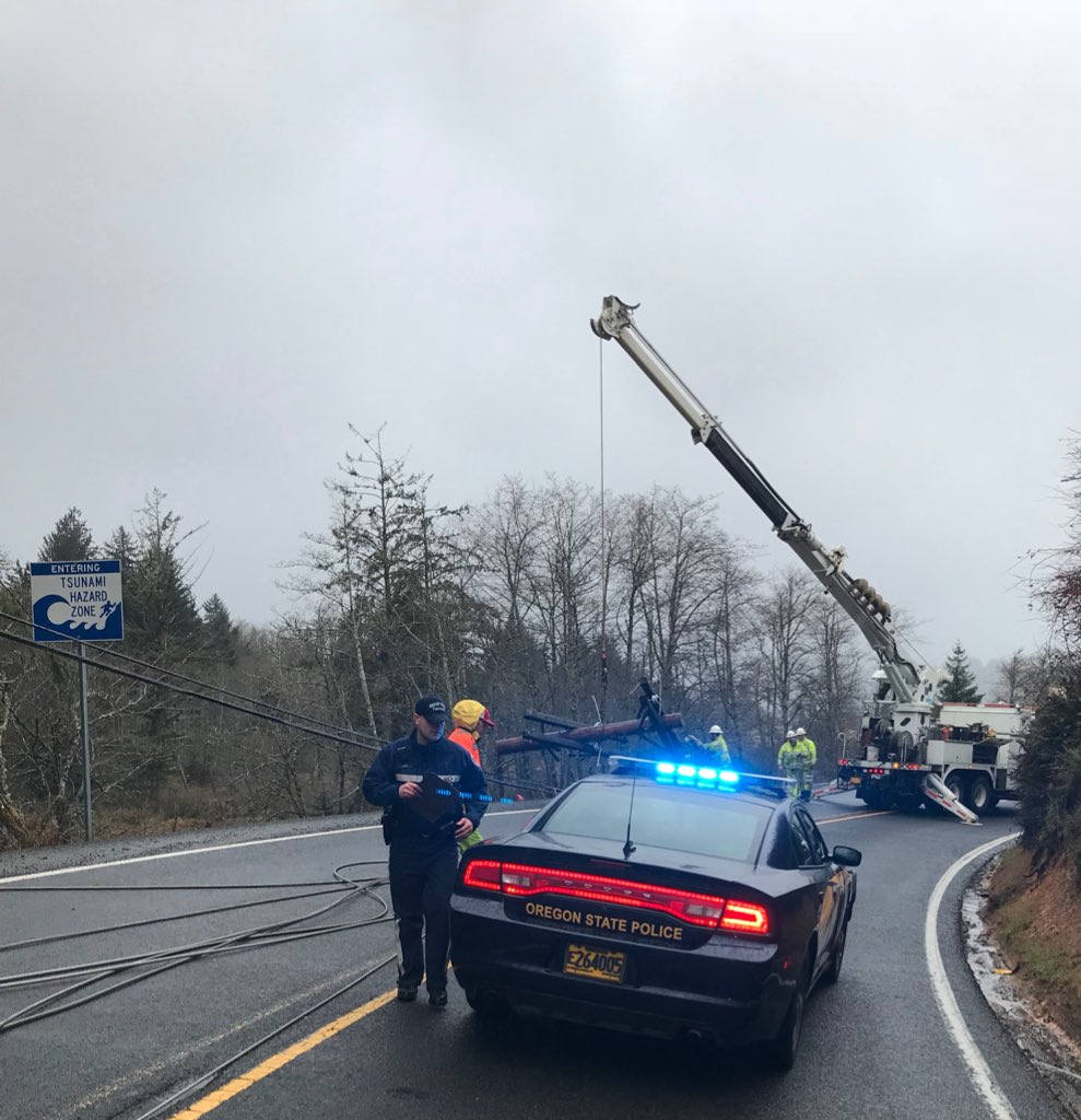 A multi-vehicle cash brought live powerlines down across Highway 101 between Lincoln City and Tillamook on Thursday morning, closing the coast highway, Oregon State Police said. (OSP)