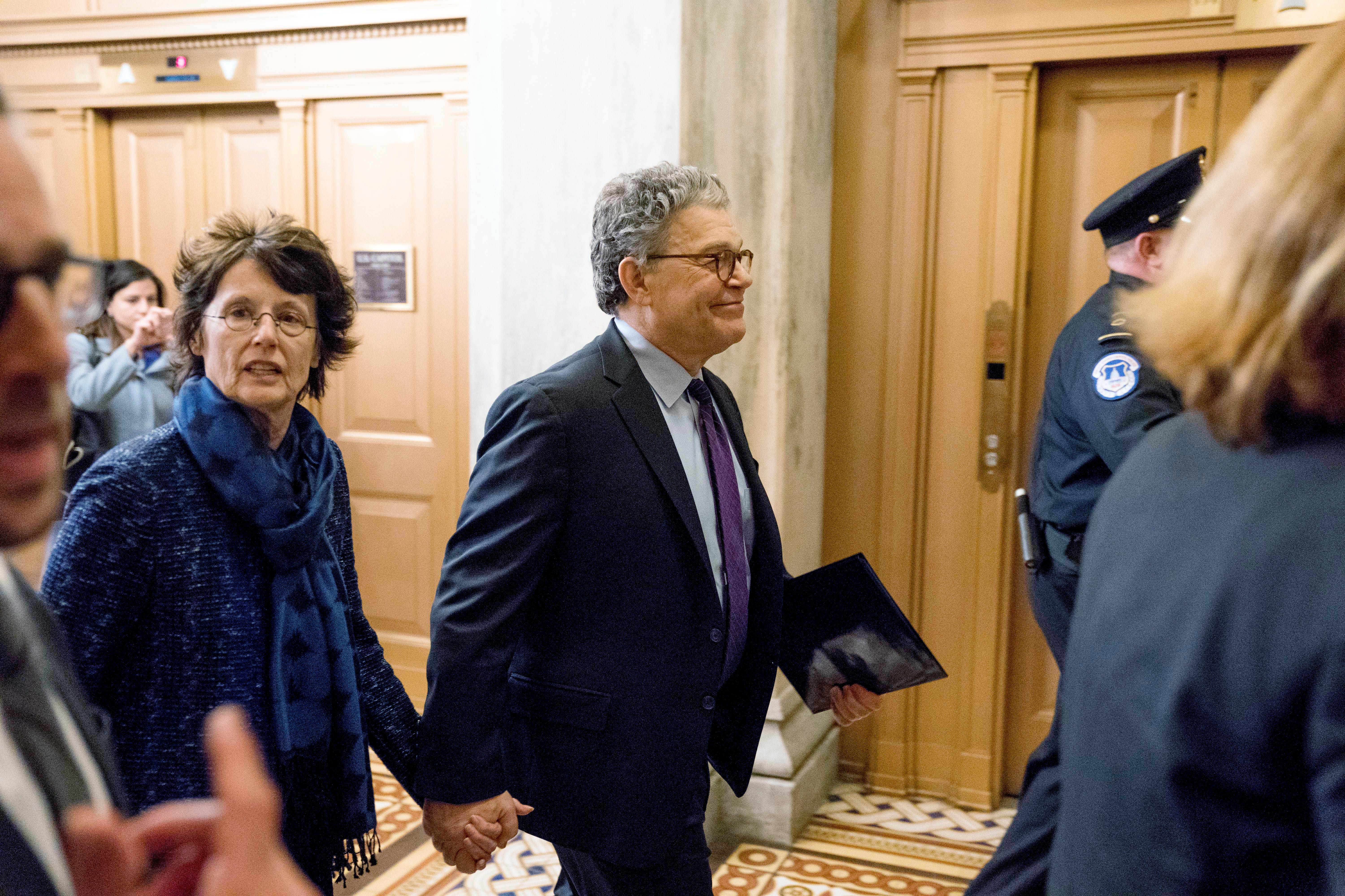 Sen. Al Franken, D-Minn., arrives with his wife Franni Bryson, left, on Capitol Hill in Washington, Thursday morning, Dec. 7, 2017. . (AP Photo/Andrew Harnik)