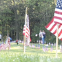 Volunteers place flags at Ft. Custer National Cemetery