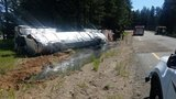 Rolled over tanker spills 3,500 gallons of liquid asphalt near Cle Elum
