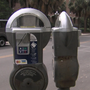 Downtown parking meters displaying mixed messages