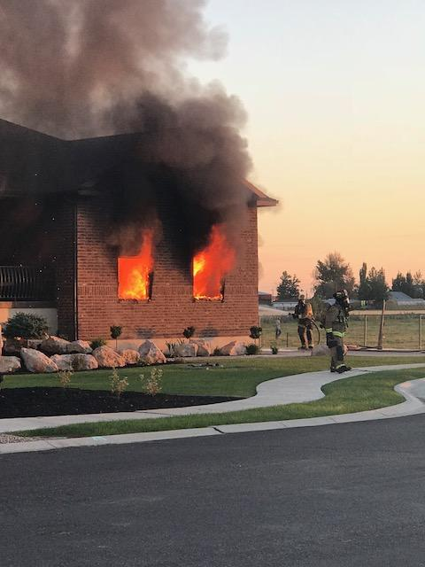 A house fire started Saturday evening in Hooper in Weber County. (Photo: Maegan Lerohl)<p></p>