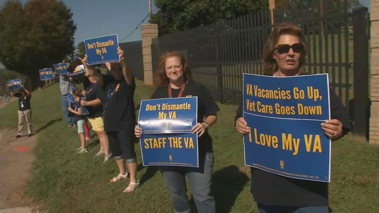 Veterans Affairs employees held a rally outside Asheville's Charles George VA Medical Center on Thursday to protest working conditions. (Photo credit: WLOS staff)