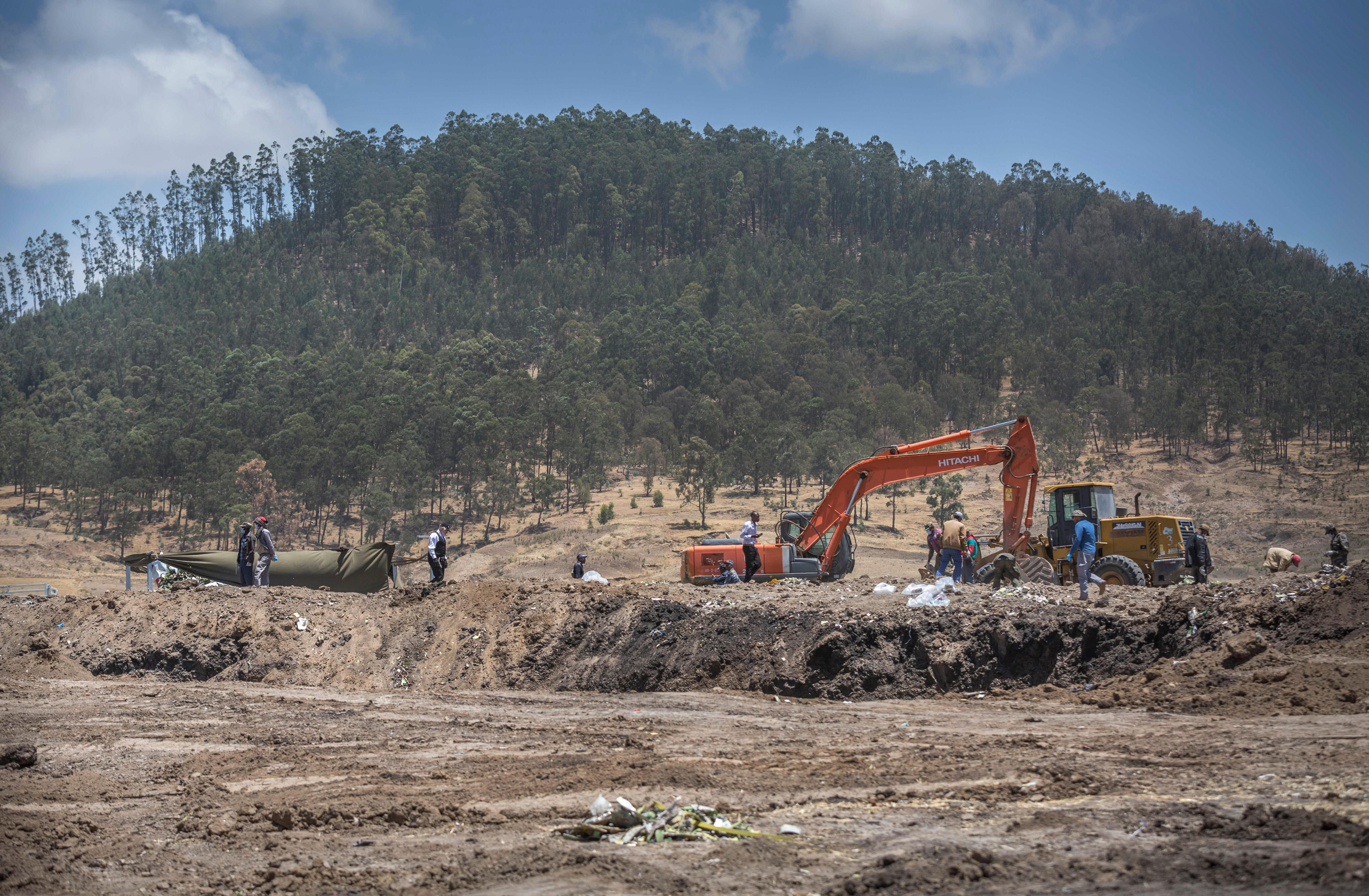 Recovery work continues at the scene where the Ethiopian Airlines Boeing 737 Max 8 crashed shortly after takeoff on Sunday killing all 157 on board, near Bishoftu, south-east of Addis Ababa, in Ethiopia Friday, March 15.. (AP Photo/Mulugeta Ayene)