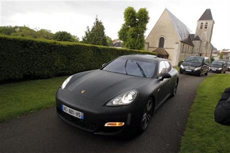 The cars of Kim Kardashian, Kanye West and their guests arrive at the entrance of the Wideville Castle, in Davron, 35 miles west of Paris, Friday, May 23, 2014.