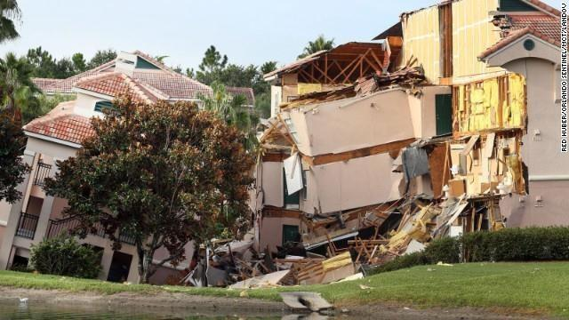 A 60-foot-wide sinkhole formed underneath the Summer Bay Resort in Florida, about 10 minutes from Walt Disney World, on Sunday. One resort building collapsed, and another slowly sank. The estimated 35 people inside the buildings were evacuated.
