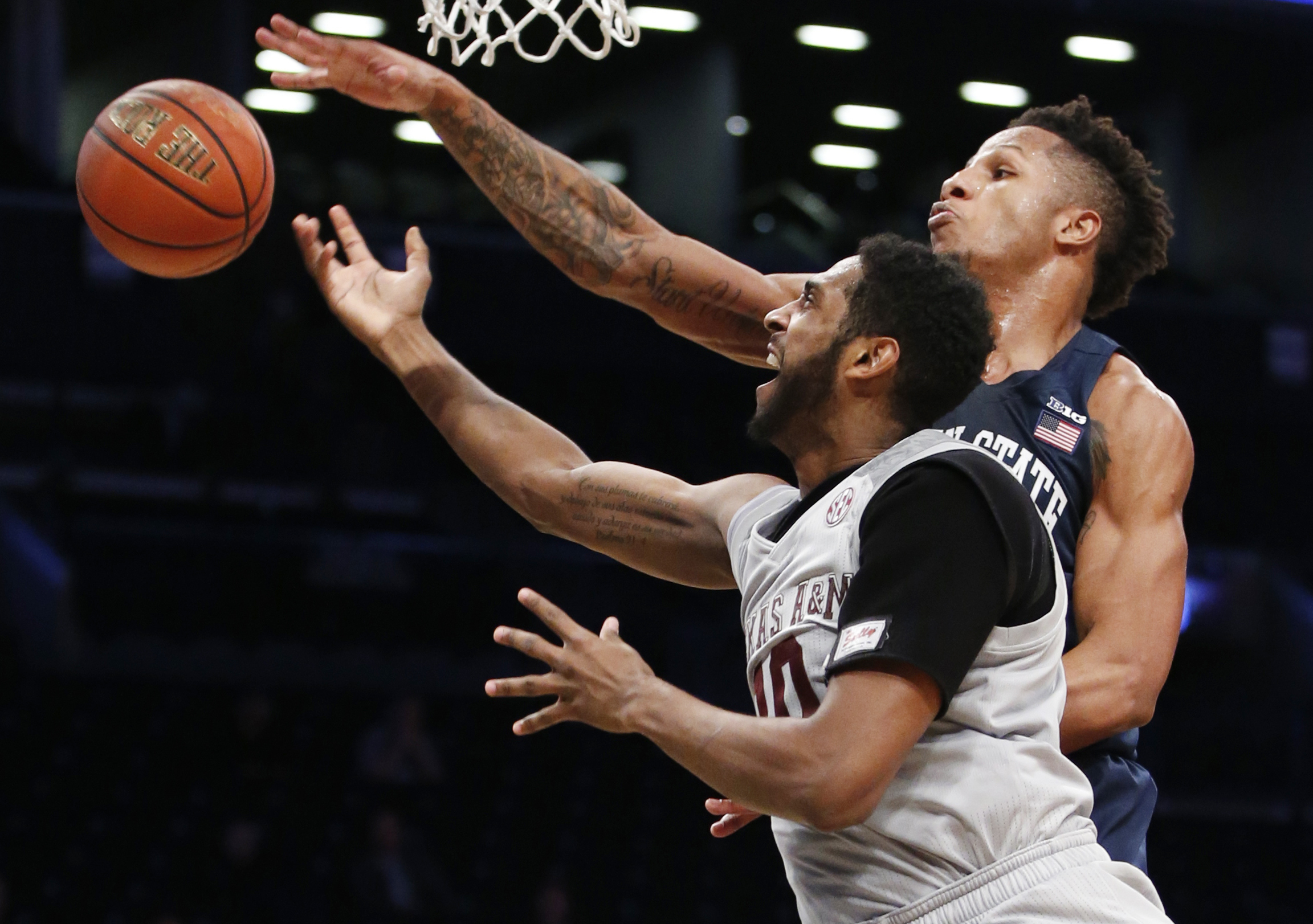 Penn State forward Lamar Stevens, above, knocks the ball from Texas A&M center Tonny Trocha-Morelos during the first half of an NCAA college basketball game in the Legends Classic tournament, Tuesday, Nov. 21, 2017, in New York. (AP Photo/Kathy Willens)